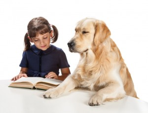 picture of a girl reading to her dog
